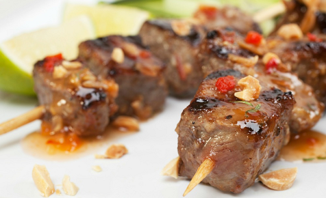 Beef skewers with sauce